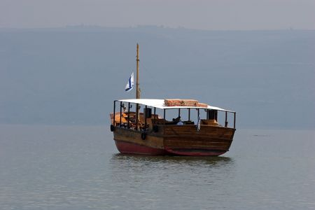 Tourists floating on a boat on the sea of Galilee Stock Photo