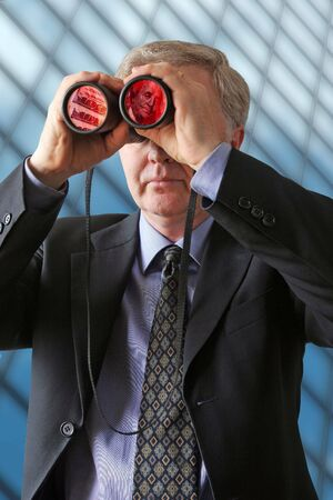 Businessman watching for new ways to develop profits Stock Photo