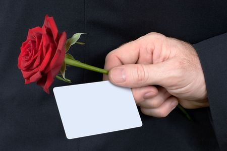 Man hand with card and red rose