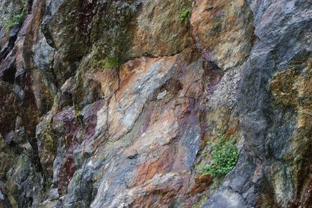 Colored granite mountain rocks as interesting background Stock Photo