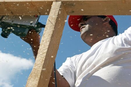 Worker polishing wood frame on top