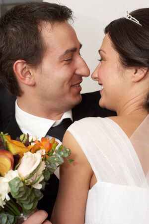 Groom embracing his bride in the beginning of the wedding day Stock Photo - 3829179