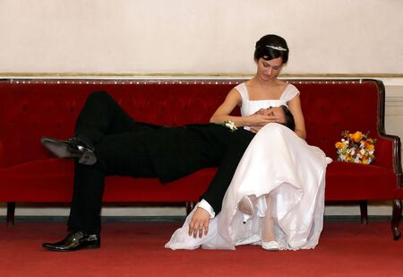 Bride and groom resting on a sofa Stock Photo - 3829182