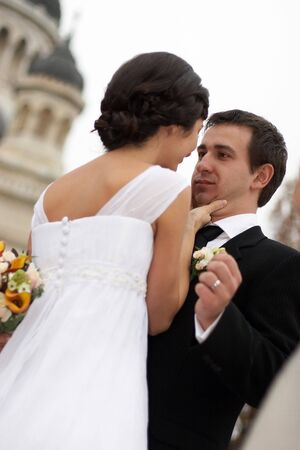 Young woman asking a kiss to her groom Stock Photo