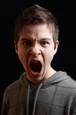 boldness: Young man shouting out his boldness and decision