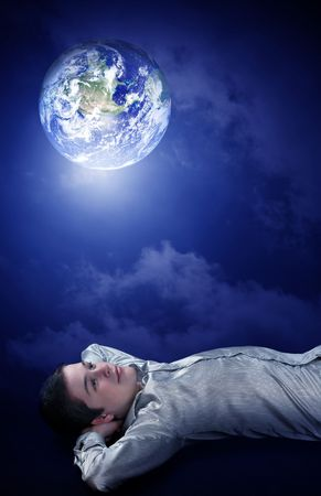 lighten: Young man dreaming to his future on earth Stock Photo