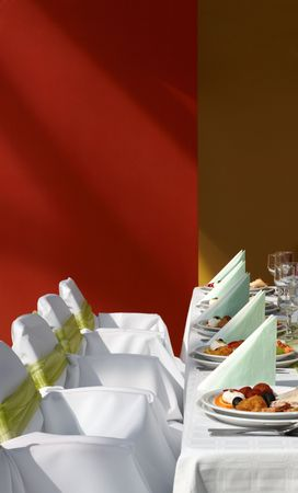 Table arrangement with decorated chairs and dinner