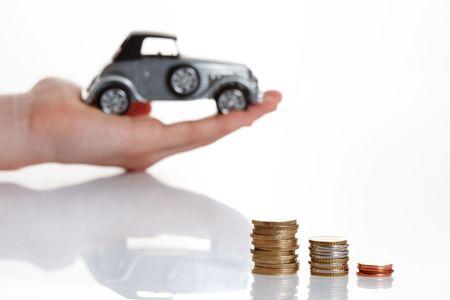 car loans: Hand presenting good offer for little money Stock Photo