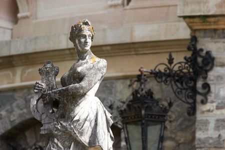 Woman singer statue at the museum castle in Europe