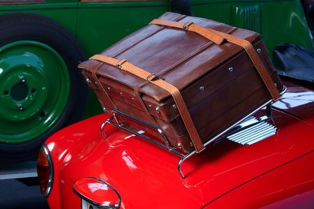 Red car with suitcase on back side Stock Photo
