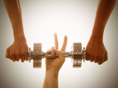Two persons help another to lift the weights. Concept of working in team.
