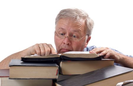 Man with glasses searching and finding intersting things in books