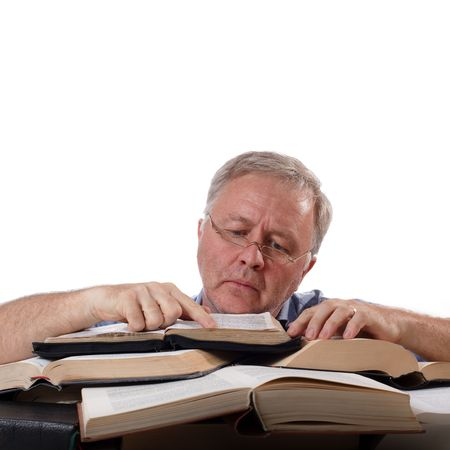 Man with glasses working with many books photo