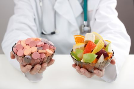 hand holding pills: Medical doctor prescribing chemical and natural vitamins
