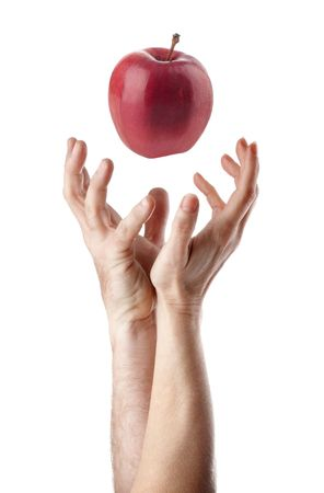 adam: Man and woman hand trying to catch an apple Stock Photo