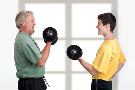 Father and son doing weight lifting together photo