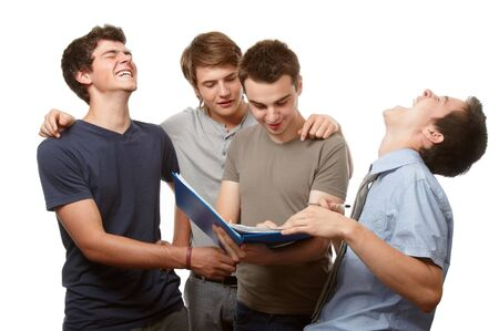 Four young people working and having fun together Stock Photo