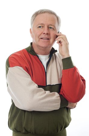 Senior man listen and smiling on his mobile Stock Photo