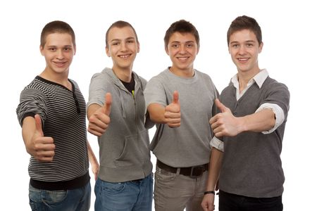 Four young friends gesturing ok  Stock Photo