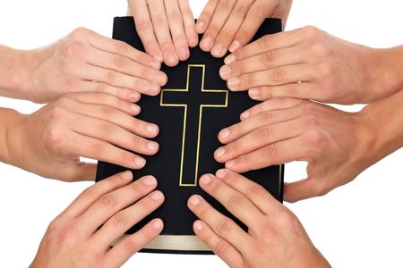 Group of people holding Holy Bible to unity and prayer photo