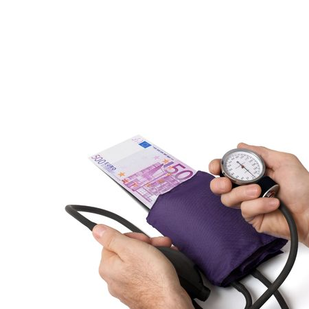 Doctor taking pressure of 500 euros. Concept for euro problem. Stock Photo - 8205389