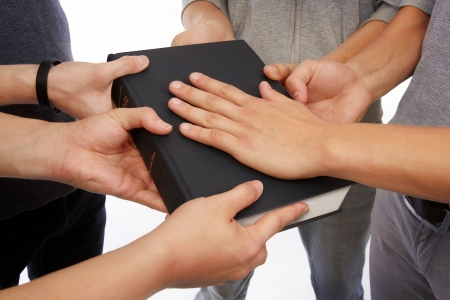 Group of people holding Holy Bible to unity, promises and prayer Stock Photo - 8272647