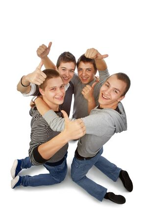 to rejoice: Four young friends knelt rejoicing for their success Stock Photo