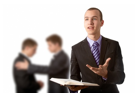 convincing: Young man preach the Gospel and other two praying in background