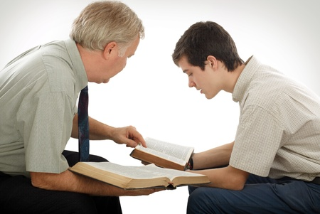 Preacher explains God's Word to a young man Stock Photo - 8601501