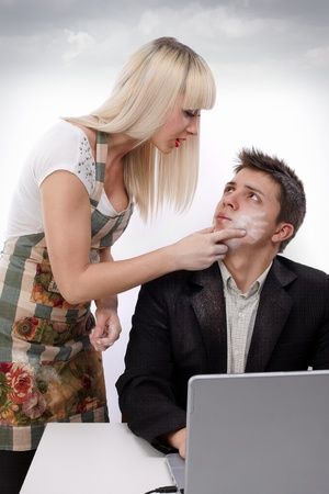 slap: Young wife arguing with her husband because shes working and his sitting at the laptop Stock Photo