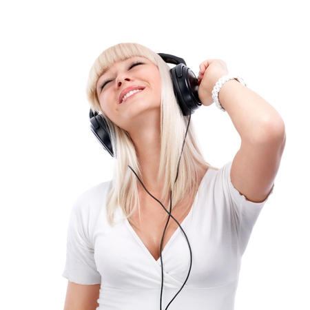 enjoys: Pretty young girl enjoys listening music  Stock Photo