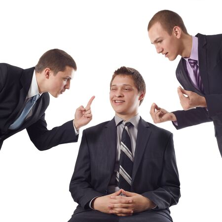 Young business man despising colleagues` and friends`  counsels