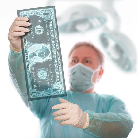 Specialist reviewing dollar x-ray before taking last decision photo