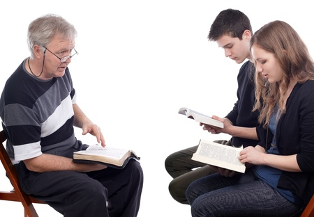 Pastor explains God's will to a young future couple Archivio Fotografico