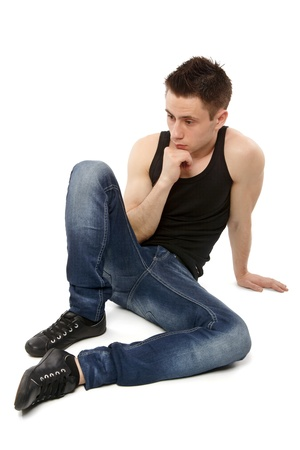 down sitting: Young man thinking and hand resting on