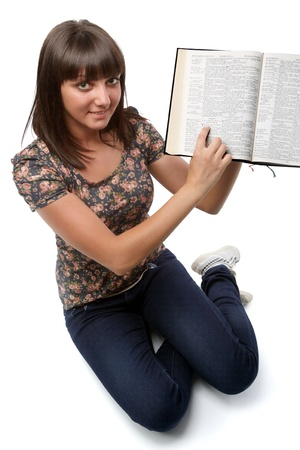 Young woman showing an important verse for her (from the Bible). photo