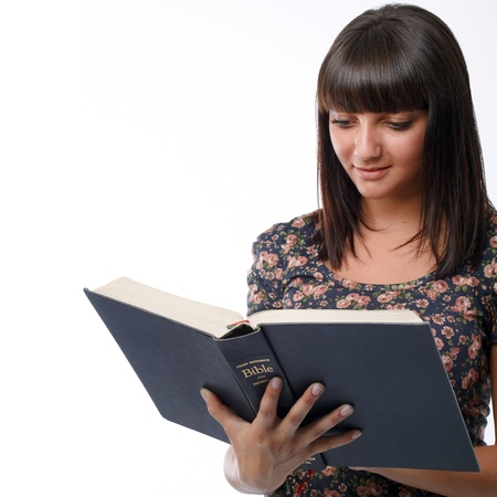 Portrait of a young woman reading the Bible photo