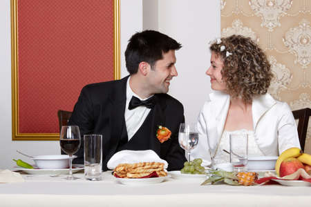 Cute bride and groom looking happily each other photo