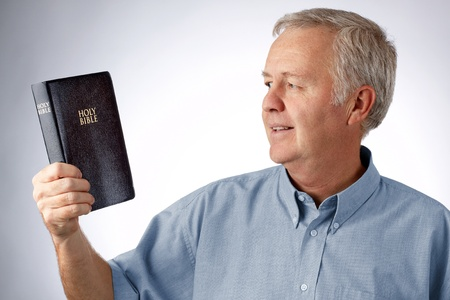 Man looking to the Bible in his hand