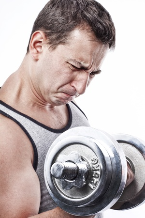 Young man doing weights lifting force