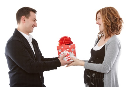 Offering a present to his pregnant wife Stock Photo - 11746576