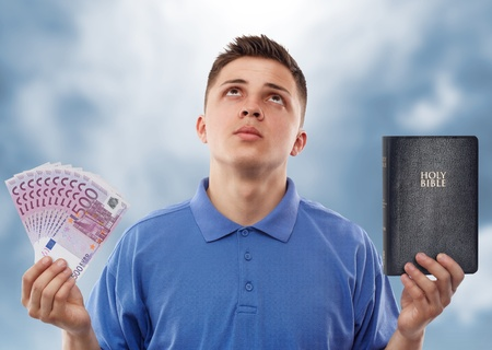 promises: Young man asking for help to choose between God and euro.