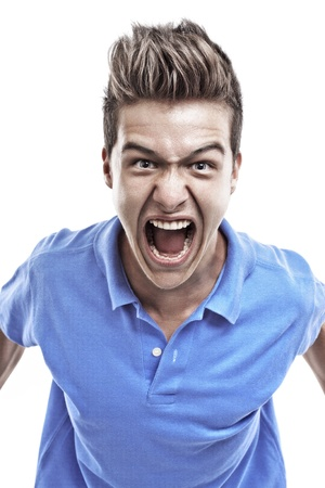 aggressive people: Angry young man in blue blouse shouting Stock Photo