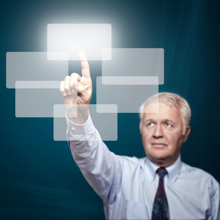 Business man pointing important things on big touch screen Stock Photo - 15045434