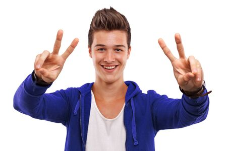 victory symbol: Portrait of a handsome young man gesturing victory symbol
