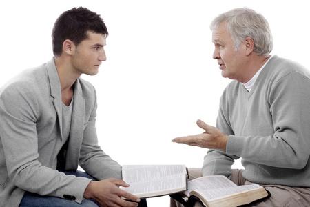 predicador: Creyente explica Dios Foto de archivo