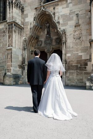 Bride and groom entering the church (concept for marriage made ??by God to unite a man and a woman in a single body) Stock Photo - 16410845