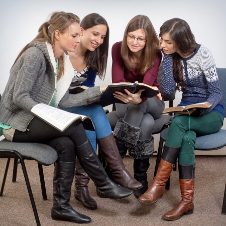 Young woman teacher teach Gods Words to a women team photo