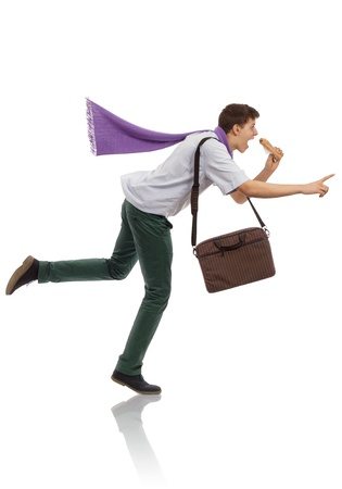 Young businessman running in a hurry