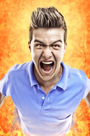 Young terrified man crying in fire. Concept for judgment day. photo